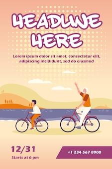 Aktiver großvater und enkel, die fahrradfliegerschablone zusammen reiten