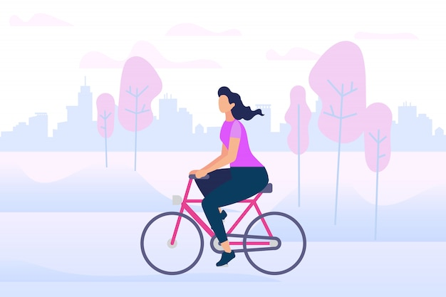 Aktives stilvolles mädchen, das fahrrad-fahrfreilicht genießt.