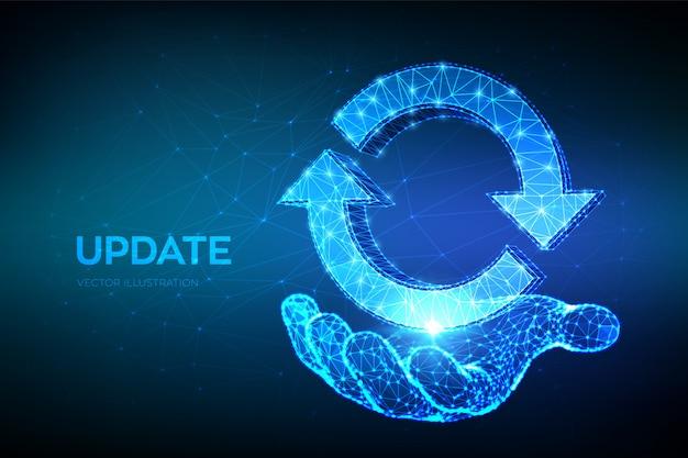 Aktualisierungs- oder synchronisierungssymbol. niedriges polygonales abstraktes update oder synchronisierungszeichen in der hand. wird bearbeitet .