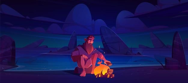 Allein verstoßener mann auf unbewohnter insel mit lagerfeuer in der nacht