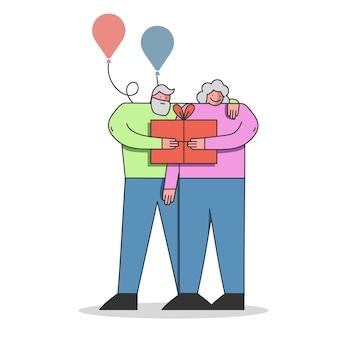 Alles gute zum geburtstag feier ältere menschen mit geschenkbox
