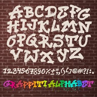Alphabet graffity vektor alphabetische schrift abc durch pinselstrich mit buchstaben und zahlen oder grunge alphabetische typografie illustration isoliert auf backsteinmauer raum