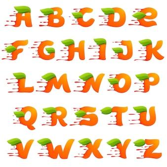 Alphabet mit orangensafttropfen und blättern.
