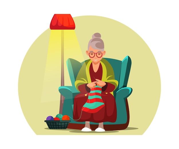 Alte frau strickt gealterte dame großmutter zeichentrickfigur oma, die im sessel mit wollfadenball und nadeln sitzt