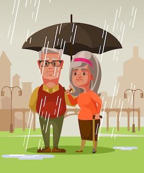 Altes ehepaar des mannmanns und der frau der zwei personen, die unter regen stehen regenschirm halten.