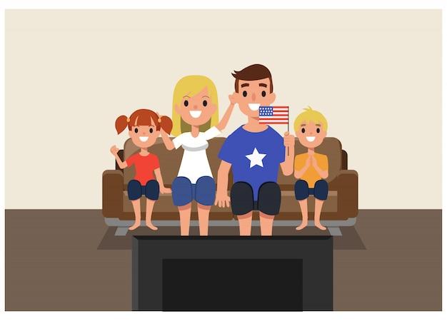Amerikanische familie, die zu hause im guss von fernsehen zujubelt.