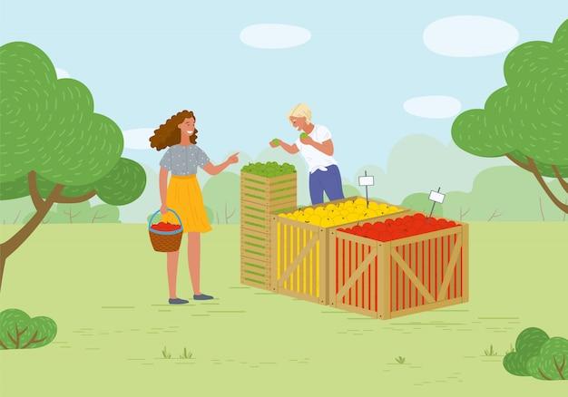 Angemessener markt im park-verkäufer mit äpfeln