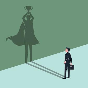 Angestellter geschäftsmann sieht sich schatten als sieger-superheld
