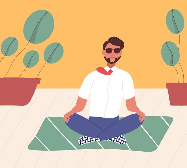 Angestellter sitzt mit gekreuzten beinen auf dem boden und meditiert. manager in yogaposition mit meditation, spiritueller praxis oder disziplin