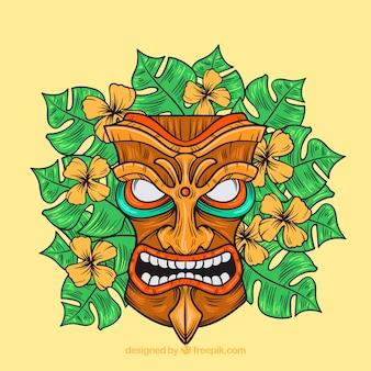 Angry tribal maske mit blumen und palmblättern
