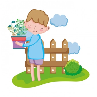Anhebender houseplant des jungen mit zaun in der landschaft