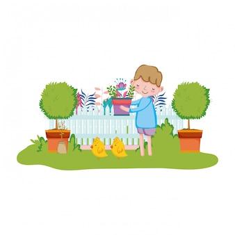 Anhebender houseplant des kleinen jungen mit zaun und küken