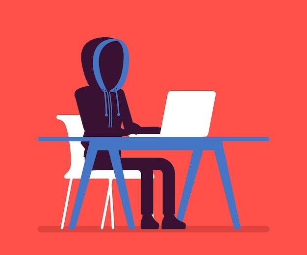 Anonymer mann mit verstecktem gesicht am laptop