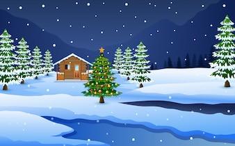 Ansicht der schneebedeckten Holzhaus- und Weihnachtsbaumdekoration
