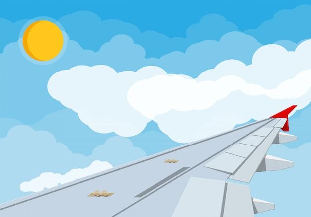 Ansicht des flügels des flugzeugs im himmel.