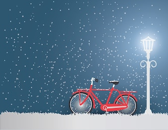 Ansichten der Wintersaison mit altem rotem Fahrrad im Park