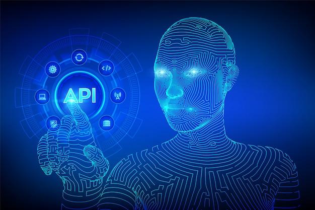 Api. anwendungsprogrammierschnittstellenkonzept auf virtuellem bildschirm. wireframed cyborghand, die digitale schnittstelle berührt.