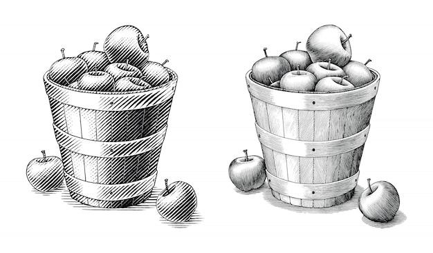 Apple in der korbhand, welche die weinleseartschwarzweiss-clipart lokalisiert zeichnet. vergleichen sie von den einfachen und komplexen zeilendarstellung