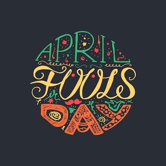 April fools day handgezeichnete schriftzug mit lächeln, spaßvogelhut und schnurrbart