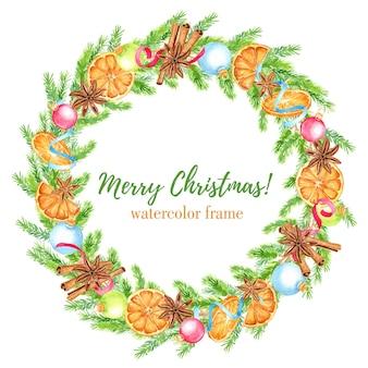 Aquarell weihnachtskranz mit tannenzweigen, orangen, anissternen und zimtstangen, weihnachtskugeln und bändern. blumenrahmen