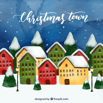 Aquarell weihnachtsstadt mit grünen, gelben und res häuser