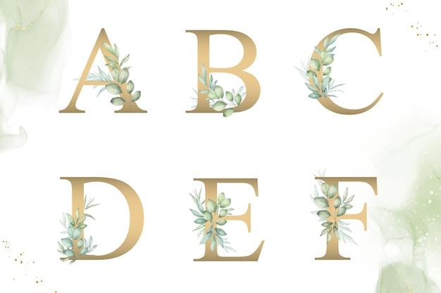 Aquarellblumenalphabetsatz von abcdef mit handgezeichnetem laub