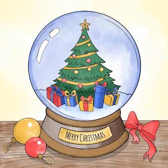 Aquarellweihnachtsschneeballkugel mit geschmücktem baum