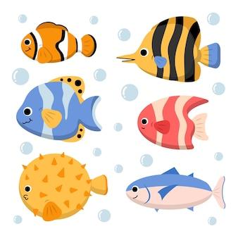 Aquatischer zeichensatz mit clownfisch kugelfisch und makrele