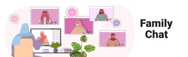 Arabische frau, die virtuelles treffen mit familienmitgliedern während des videoanruf-online-kommunikationskonzepts hat