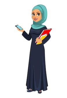 Arabische geschäftsfrau, die smartphone hält