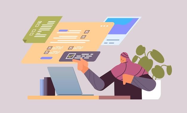 Arabische geschäftsfrau, die vollständige aufgaben auf der virtuellen checkliste der unternehmensorganisation erfolge des zielkonzepts horizontale porträtvektorillustration markiert