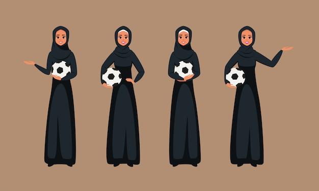 Arabische junge frauen, die mit fußball in den verschiedenen haltungen stehen.