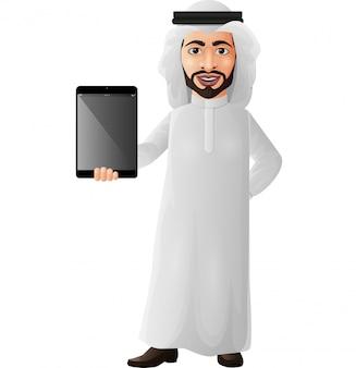 Arabischer geschäftsmann, der eine tablette hält