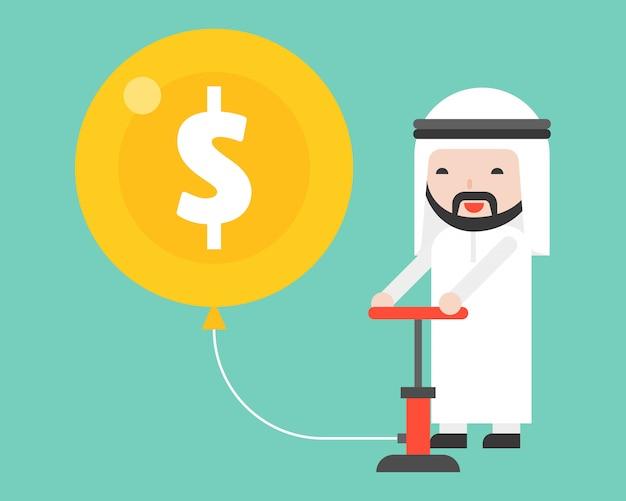 Arabischer geschäftsmann, der geldluftballon pumpt