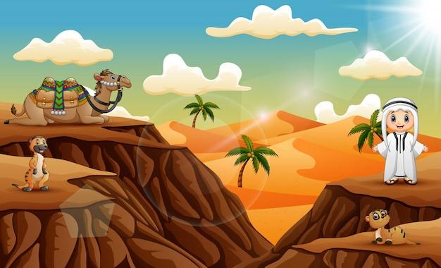 Arabischer junge mit reichlich tier auf der wüste