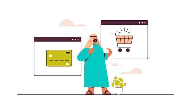Arabischer mann, der smartphone-anwendung für online-shopping-bestellung und bezahlung des intelligenten e-commerce-einkaufs verwendet
