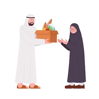 Arabischer mann, der spenden-box-nahrung für alte frau gibt