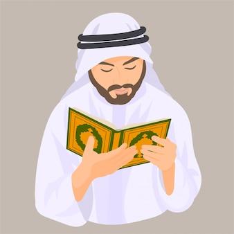 Arabischer muslimischer mann, der heiligen koran liest