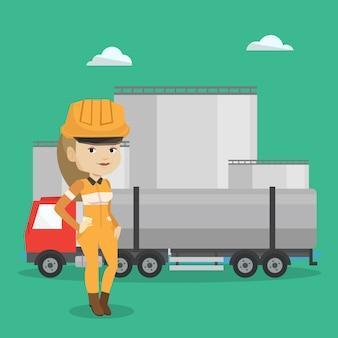 Arbeiter auf hintergrund des tankwagens und der ölanlage.