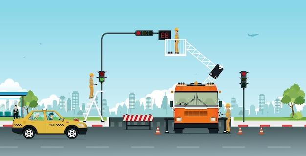 Arbeiter, die ampeln reparieren, schalten vorübergehend straßen aus.