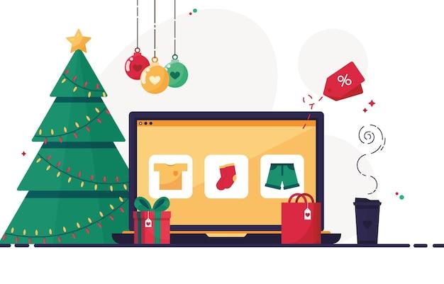 Arbeitsplatz mit weihnachtsdekoration und computer-laptop, um geschenke für die feiertage zu bestellen