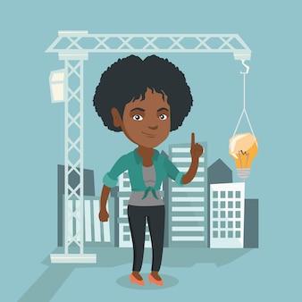 Architekt, der auf die glühlampe hängt am kran zeigt.