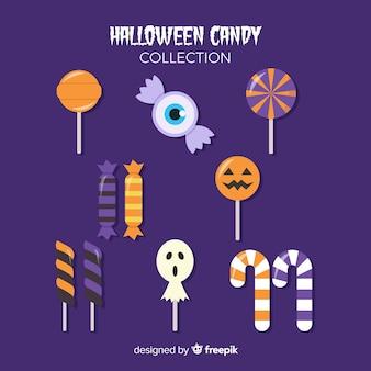 Aromatische süßigkeiten für halloween-nacht auf violettem hintergrund