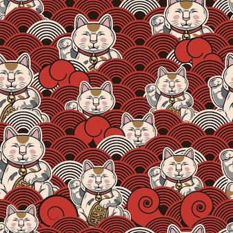 Asiatisches buntes nahtloses muster mit glücklichen katzen und japanischen wellen