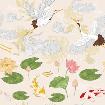 Asiatisches muster mit goldenen karpfen, die kraniche fliegen und wolken mit lotusblumen, karpfenkräne