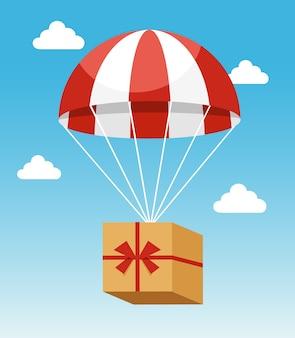 Attraktiver roter und weißer fallschirm, der lieferung pappkarton auf hellblauem himmelhintergrund trägt