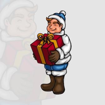 Aufgeregter kleiner junge mit seinem weihnachtsgeschenk