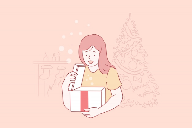 Aufgeregtes kleines kind mit überraschung, kind, das neujahrsgeschenk erhält. glückliches mädchen, das festliches geschenk, weihnachtsfeiertagsfeier, wintersaisontradition auspackt. einfache wohnung