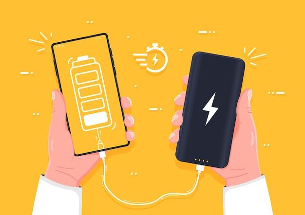 Aufladen des geräts menschliche hand, die das aufladen des smartphones hält, verbinden sie sich mit der konzeptionellen powerbank