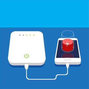 Aufladen des smartphones mit niedrigem akku und externer power bank auf dem tisch